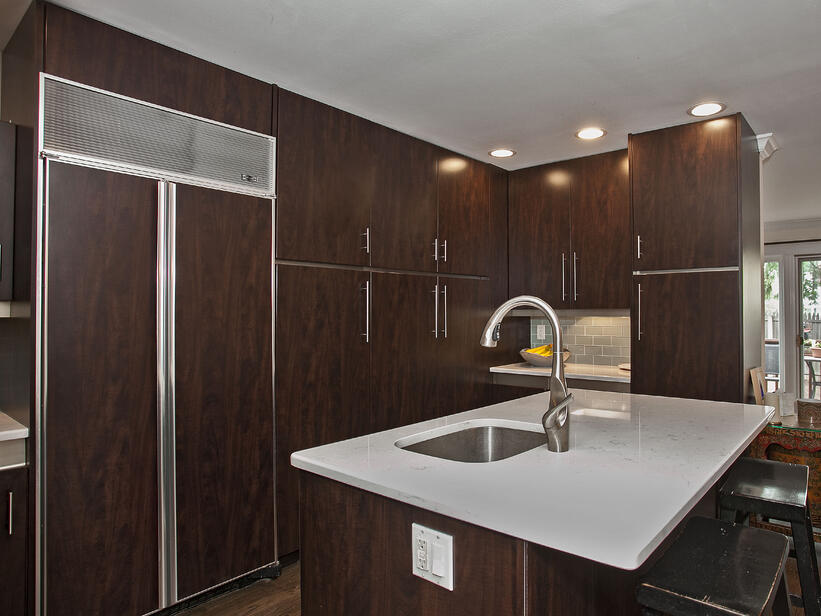 Modern Kitchen with Chocolate Pear Cabinets and Glass Tile Backsplash