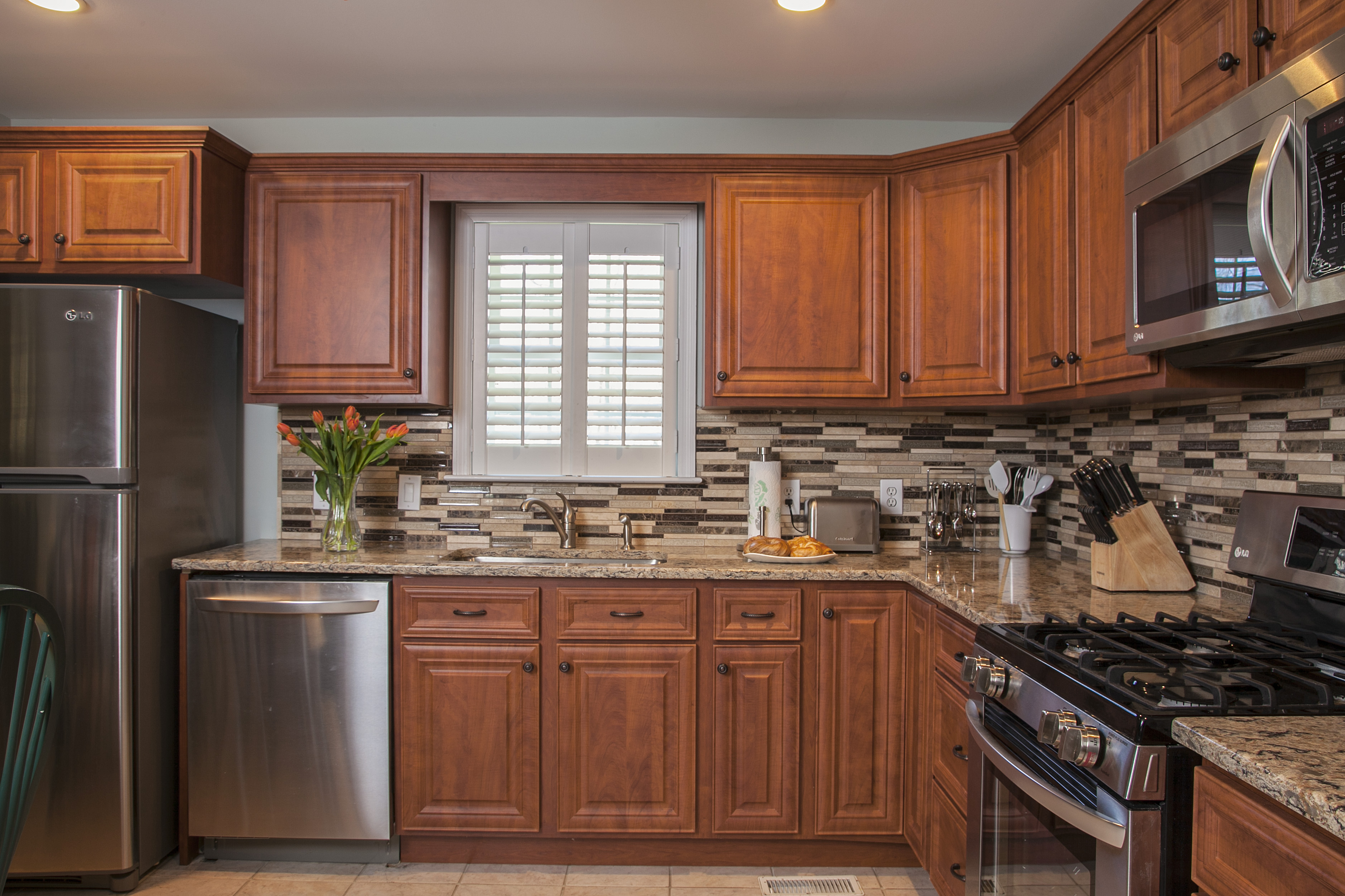 Kitchen Remodel with Tile Backsplash and Cherry Cabinets