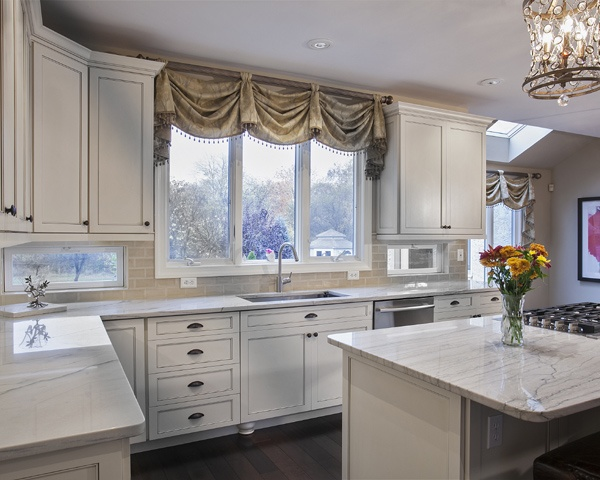 Kitchen with White Cabinets and Backsplash Windows
