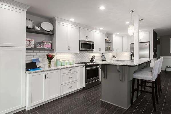 White Kitchen with Shaker Cabinets and Gray Island