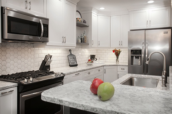 Kitchen with White Cabinets, Subway Tile, and Honeycomb Backsplash