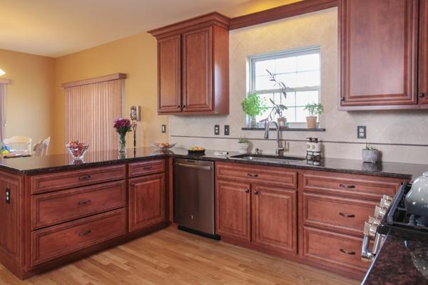 Cherry Kitchen Cabinets and Black Granite Countertop