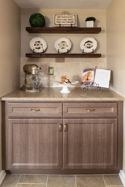 Open Shelving the Ideal Way to Break up a Line of Cabinets.