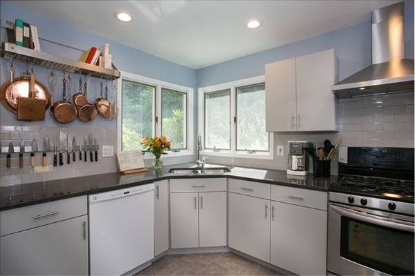 Replace upper cabinets with shelving for interest