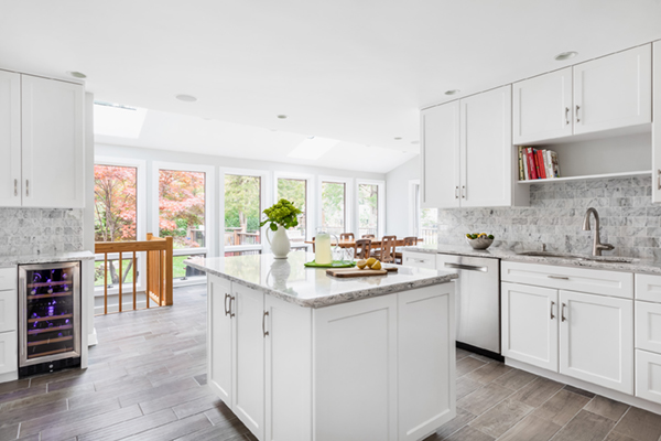 open concept white kitchen refacing with island