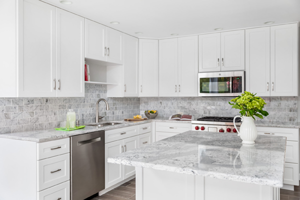 white kitchen renovation with light marbled countertops