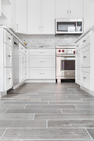 white kitchen remodel with gray barnwood tile