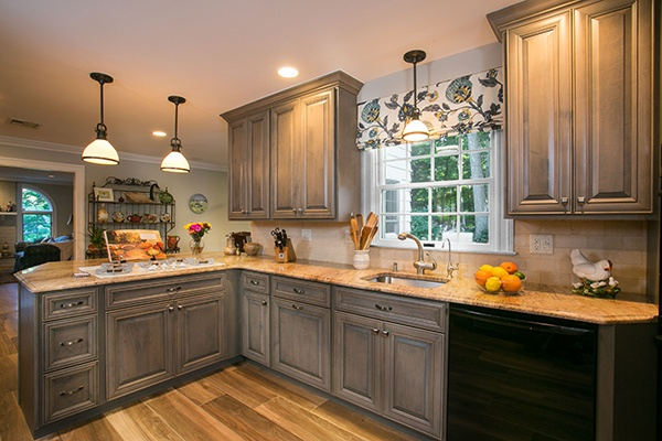 We married the cabinets to the countertop using a brown glaze