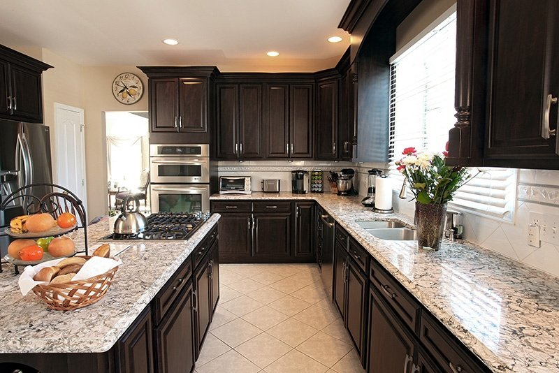 The perfect transitional kitchen design in chocolate pear for Chocolate brown kitchen designs
